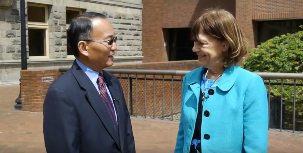 Dr. Shouan Pan and former chancellor Jill Wakefield. (Screencap from YouTube video)