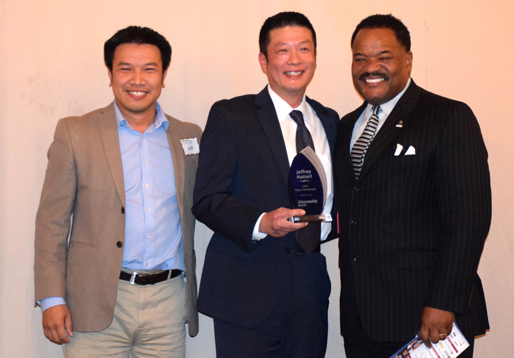 From left: Award presenter and sponsor representative Tien Ha (HACT Construction), honoree Jeffrey Hattori (Keiro Northwest), honoree introducer and sponsor representative Nate Miles (Lilly).