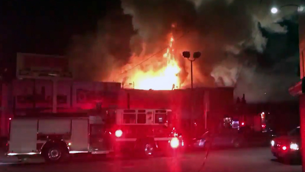 This photo taken from video provided by @Oaklandfirelive shows the scene of the fire on Dec. 3.
