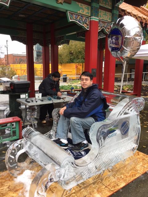 John Liu on an ice-sculptured sleigh.