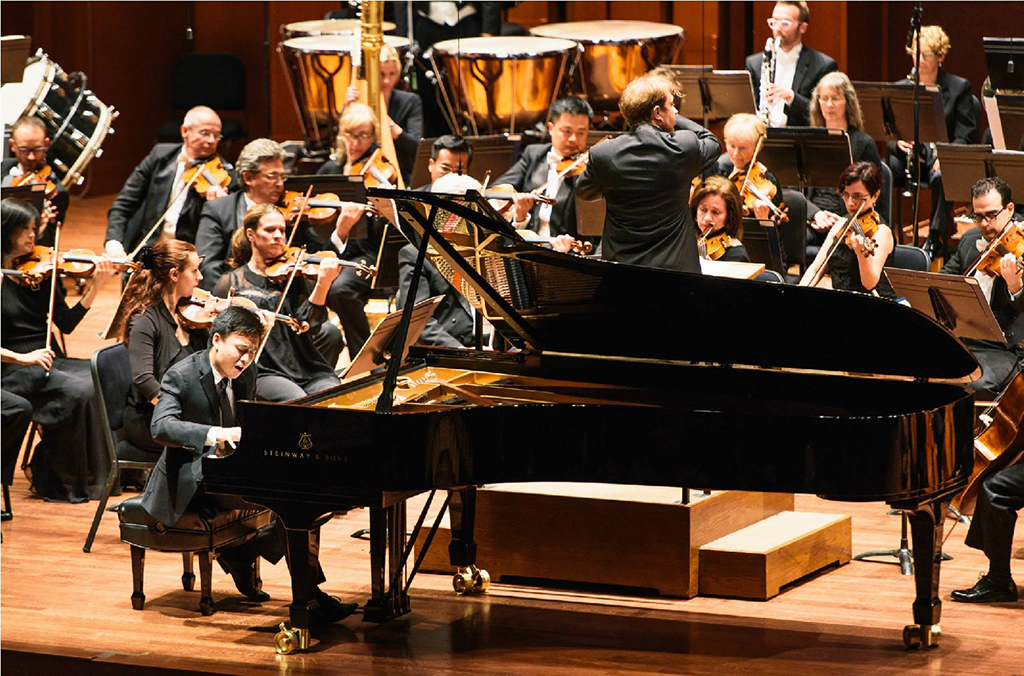 Kevin Ahfat performs the final movement of Barber's Piano Concerto with Ludovic Morlot and the Seattle Symphony. (Brandon Patoc Photography)