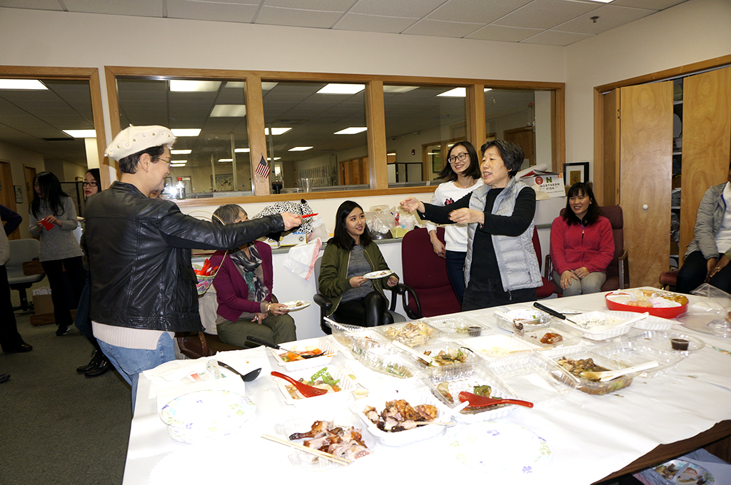 Giving out red envelopes at our annual Lunar New Year lunch. (Photo by George Liu/NWAW)