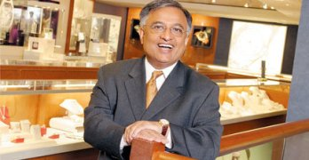 Indian American businessman charged with defrauding lenders