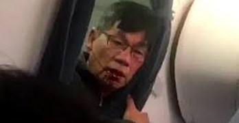 Passenger who was dragged off jetliner settles with United