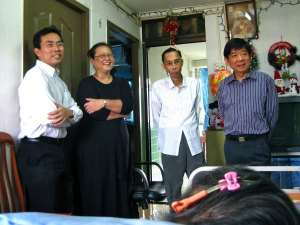Dr Ng Wai Chong CEO of NWC Longevity Practice visiting a patient with then Minister for Health Mr Khor Boon Wan