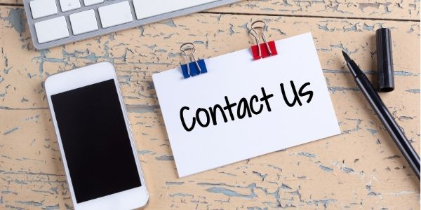 Contact Us written on card