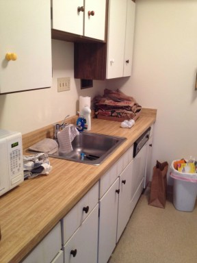 These are the original 1960s cabinets!  This kitchen is long overdue for a renovation