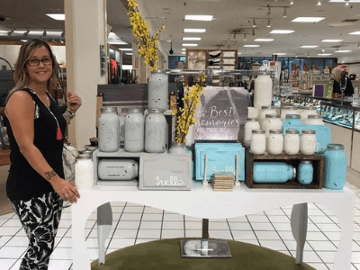 Woman with a table of items for sales