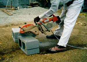 NO DUST: A hose attaches to this concrete saw, which creates silica slurry instead of silica dust.