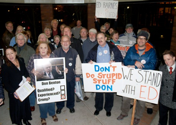 Several dozen people gathered before the Nov. 19 meeting of the Clark County board of commissioners in a show of support for Vancouver, Washington, resident Ed Barnes (center behind the Don Benton poster). The former union official was threatened with a defamation lawsuit by Don Benton, who was appointed last May to head the county's Department of Environmental Services. Barnes has been an outspoken critic of the controversial hiring.
