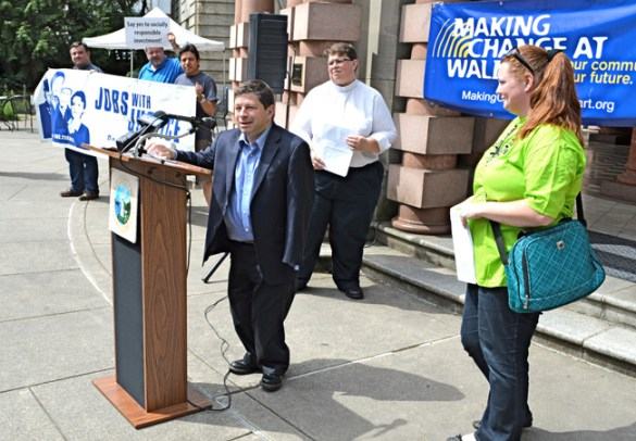 Portland City Commissioner Steve Novick announces the beginning of the City's disinvestment in Walmart bonds.  He was joined by members and leaders of UFCWLocal 555,  Yvette Brown of OUR Walmart (right), and  Pastor Tara Wilkins (center) of Bridgeport United Church of Christ.