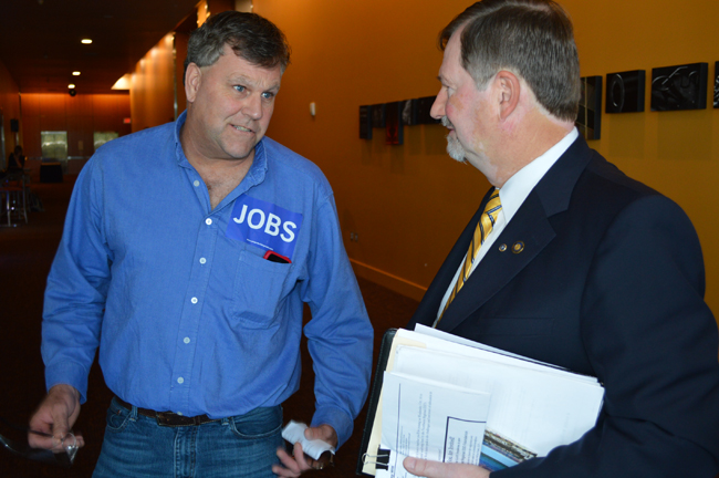 Russ Garnett, business manager of Roofers Local 49, talks to State Rep. Brad Witt in the hallway of the Salem Convention Center, site of a public hearing by the Oregon Transportation Commission regarding ConnectOregon V project funding recommendations.