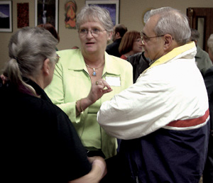 Mary Botkin (center) talks with Multnomah County Commissioner Lonnie Roberts at a community forum.