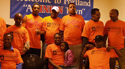 FREE AT LAST: Cabbies celebrate the 2012 Portland City Council ordinance that allowed them to form Union Cab … and end their sharecropper relationship with Broadway Cab.