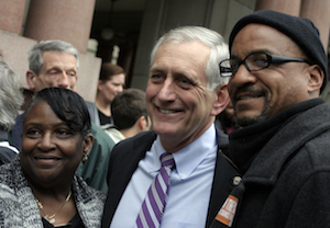 "Portland mayor Charlie Hales mingles with ""ban the box"" supporters outside City Hall"