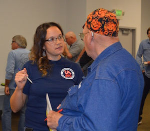 Before class, wellness program coordinator Tori Geter checks in with a Local 290 retiree.