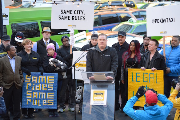Portland's Pioneer Courthouse Square is filled with taxis for a Jan. 12 rally. Rallygoers called for Uber and Lyft to be subject to the same rules as taxis if Portland was going to allow them to operate. In the end, Portland City Council approved rules Dec. 2 that favor the app-based competitors with less stringent and thus less expensive insurance requirements.
