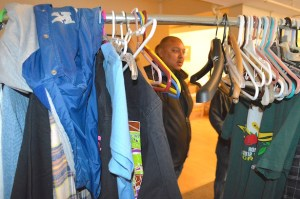 Local 48 Organizer Aaron B. Strong sorts through clothes at Union Gospel Mission.