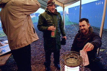dry socks: The first requirement of any campaign Karl Krupicka and Joe Barton use a camp stove to get dry after several hours of picket duty in a winter rain storm.