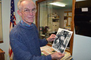 Retired Letter Carrier Dave McGann looks at an old photograph of himself as a child with his grandfather — Portland Letter Carrier Kinard Irving Dixon. The picture was taken in the late 1940s at Southeast 104th and Harold. McGann worked for the Post Office for 44 years, delivering mail out of the Kenton Post Office for 17 years, and the St. Johns Post Office for 27 years. After retiring in 2005, he became a volunteer for Meals on Wheels, where he delivers meals to senior citizens every day of the week.