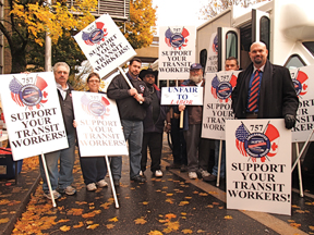 ATU Local 757 members, and president Jon Hunt, right, picket at Portland State University.