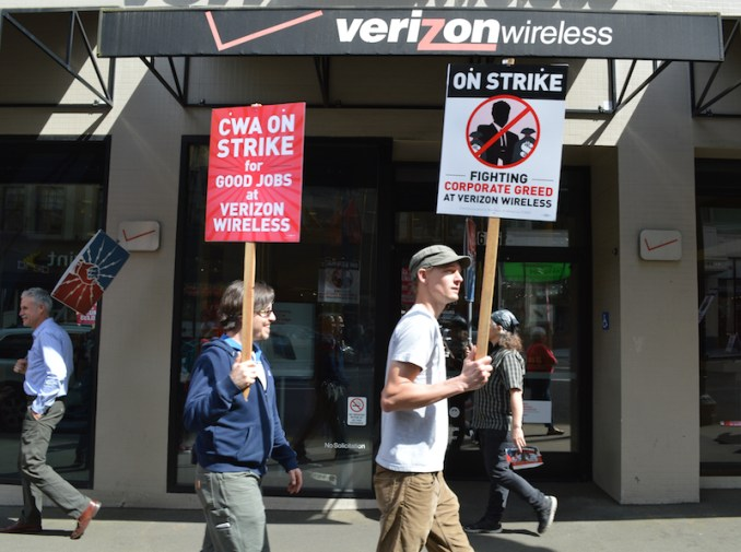 Portland Jobs with Justice organized a May 5 picket outside the downtown Portland Verizon Wireless store. Staff of IBEW Local 48 took part, as did members of CWA Local 7901 from Portland's First Unitarian Church.
