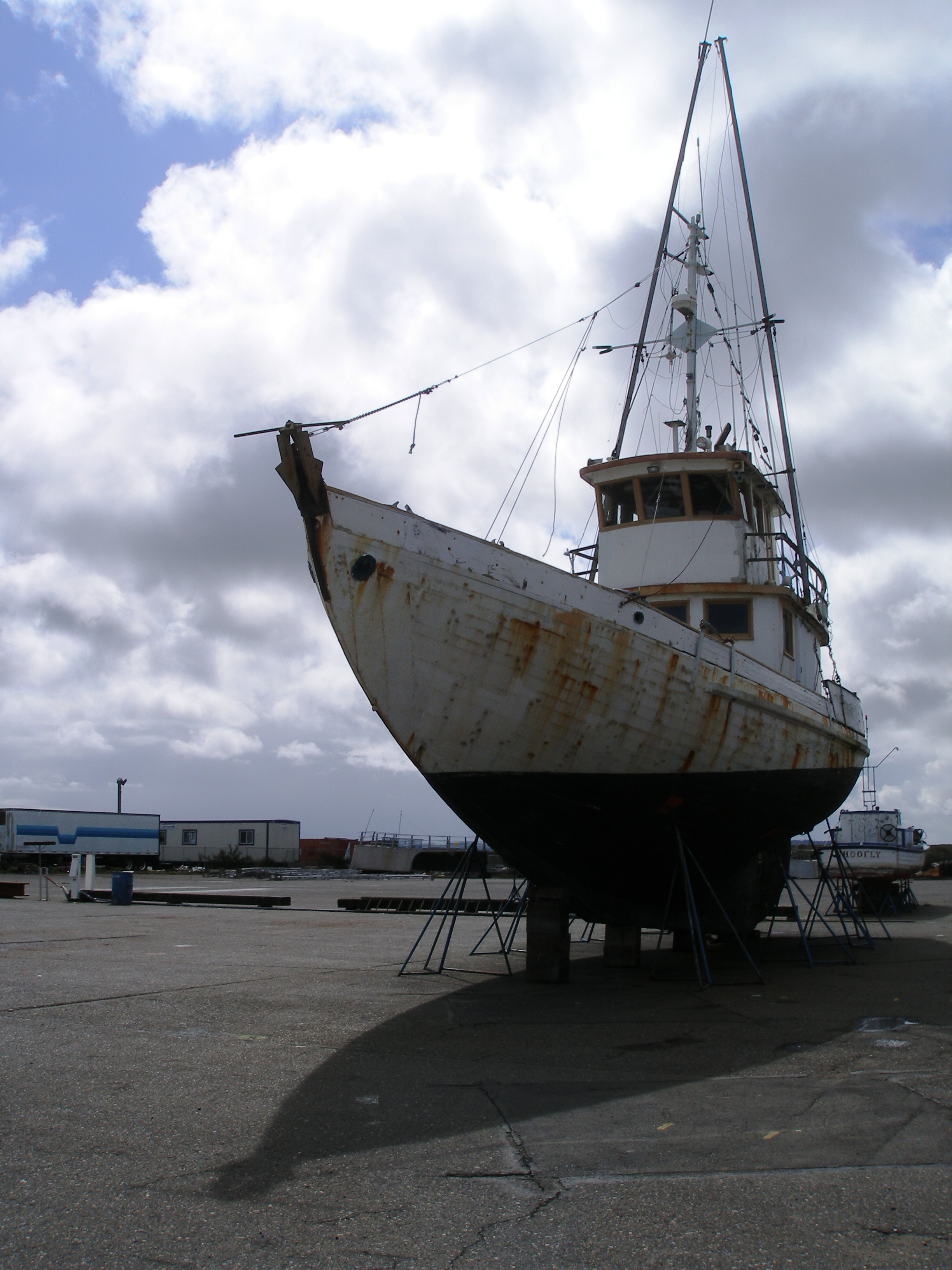 Unwieldy-looking out of water, this old tuna boat waits for paint