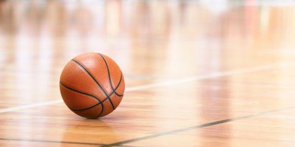 Photo of basketball on gym floor
