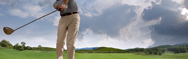 A man swings for a golf ball