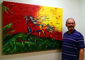"""Artist Mike Tollesen with his painting """"Leaving the Past Behind."""""""