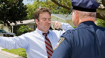 Police officer giving a roadside sobriety test.