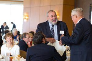 50-year member Garfield Jeffers greets a fellow honoree.