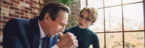 Worried female psychiatrist speaking to client
