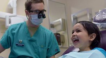 Dentist treats a young girl in cowgirl boots