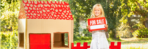 Little girl selling her playhouse