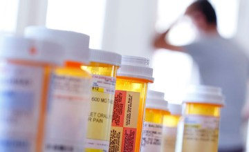Several bottles of prescription medication on a table.