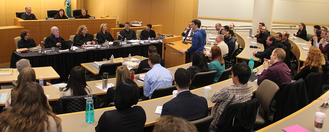 Supreme Court justice with students in Seattle University's Fred Dore Courtroom