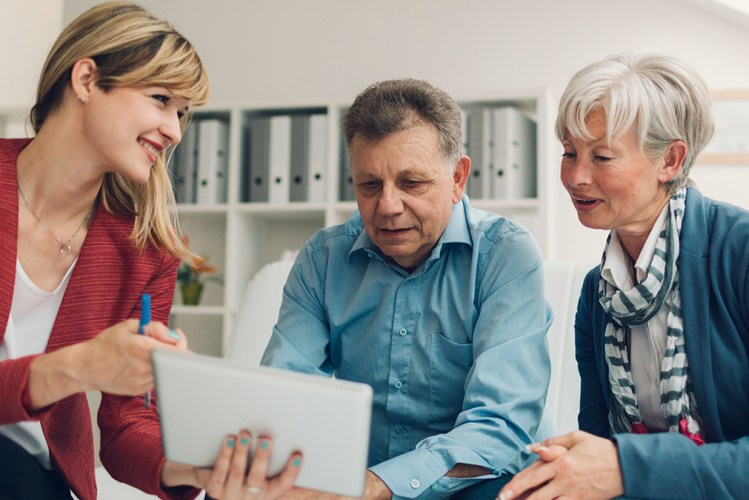 An attorney consulting a senior couple
