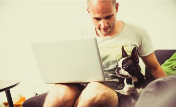 Teleworking man with dog
