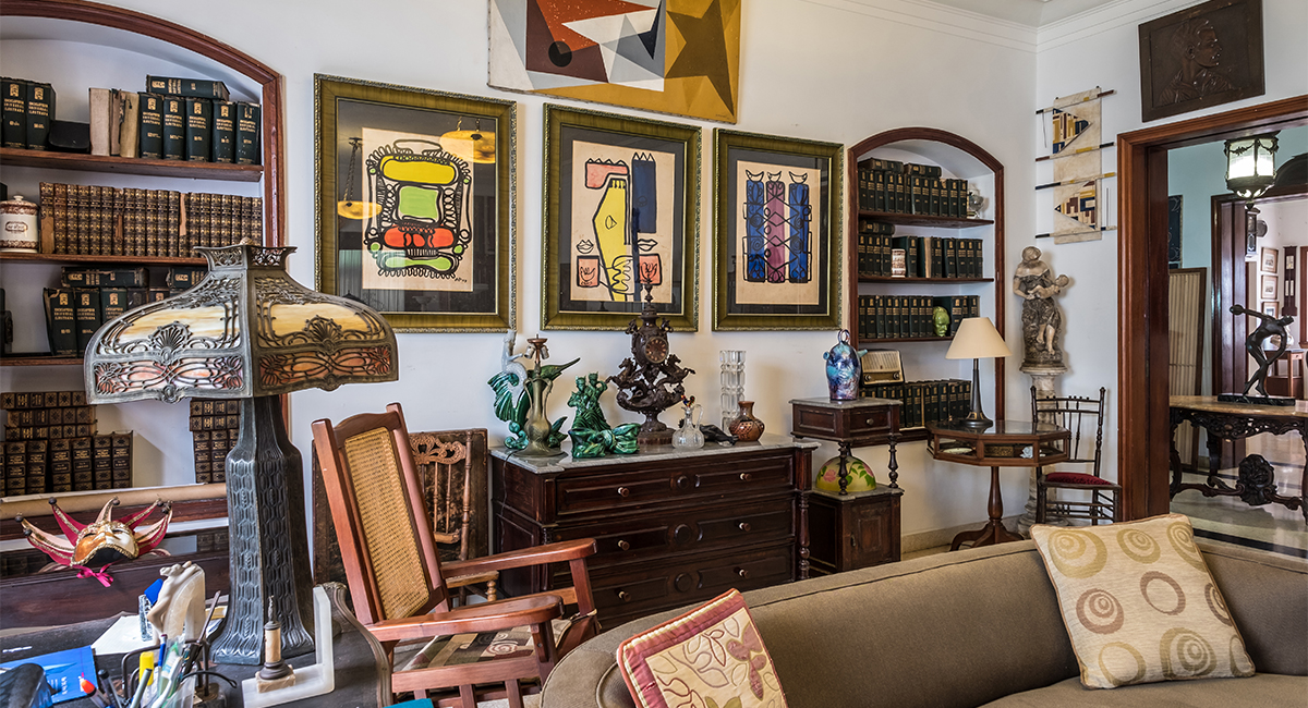 Art. paintings on the walls inside an eclectic home.