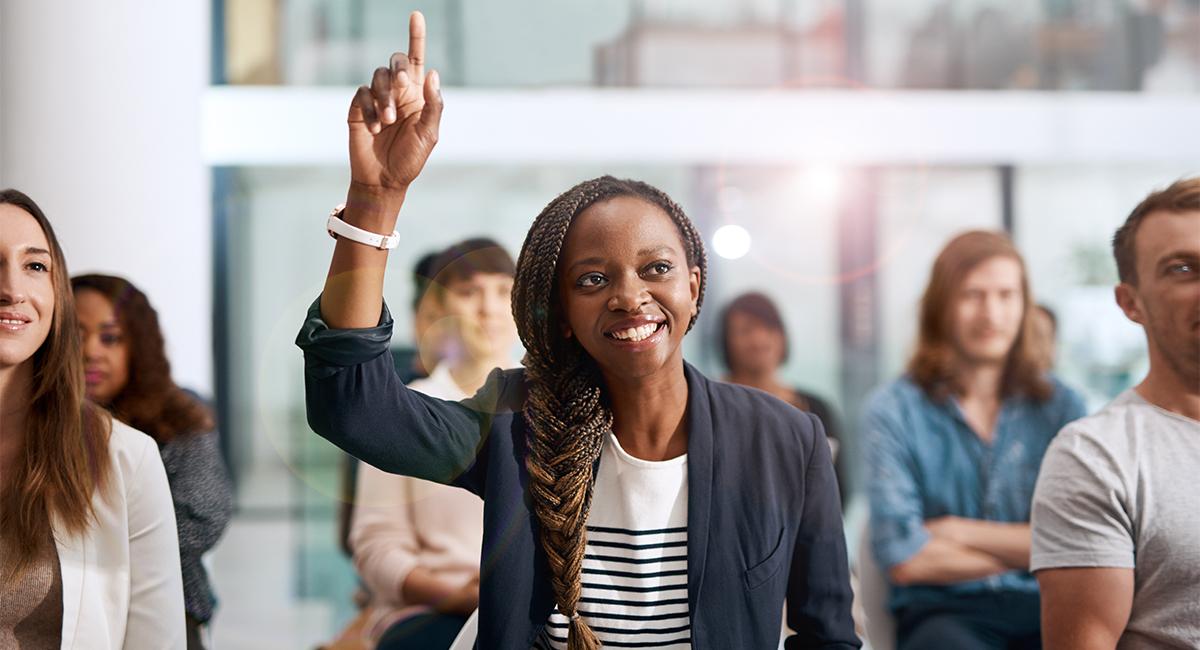 Woman raises her hand t o volunteer
