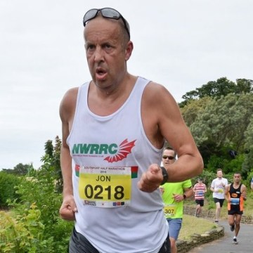 Jon Evans battles Southport breeze and is first North Wales Road Runner home
