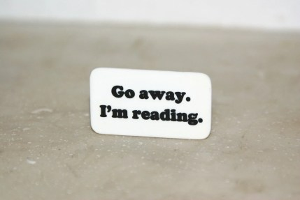 Go away I'm reading - Black and white pinback brooch