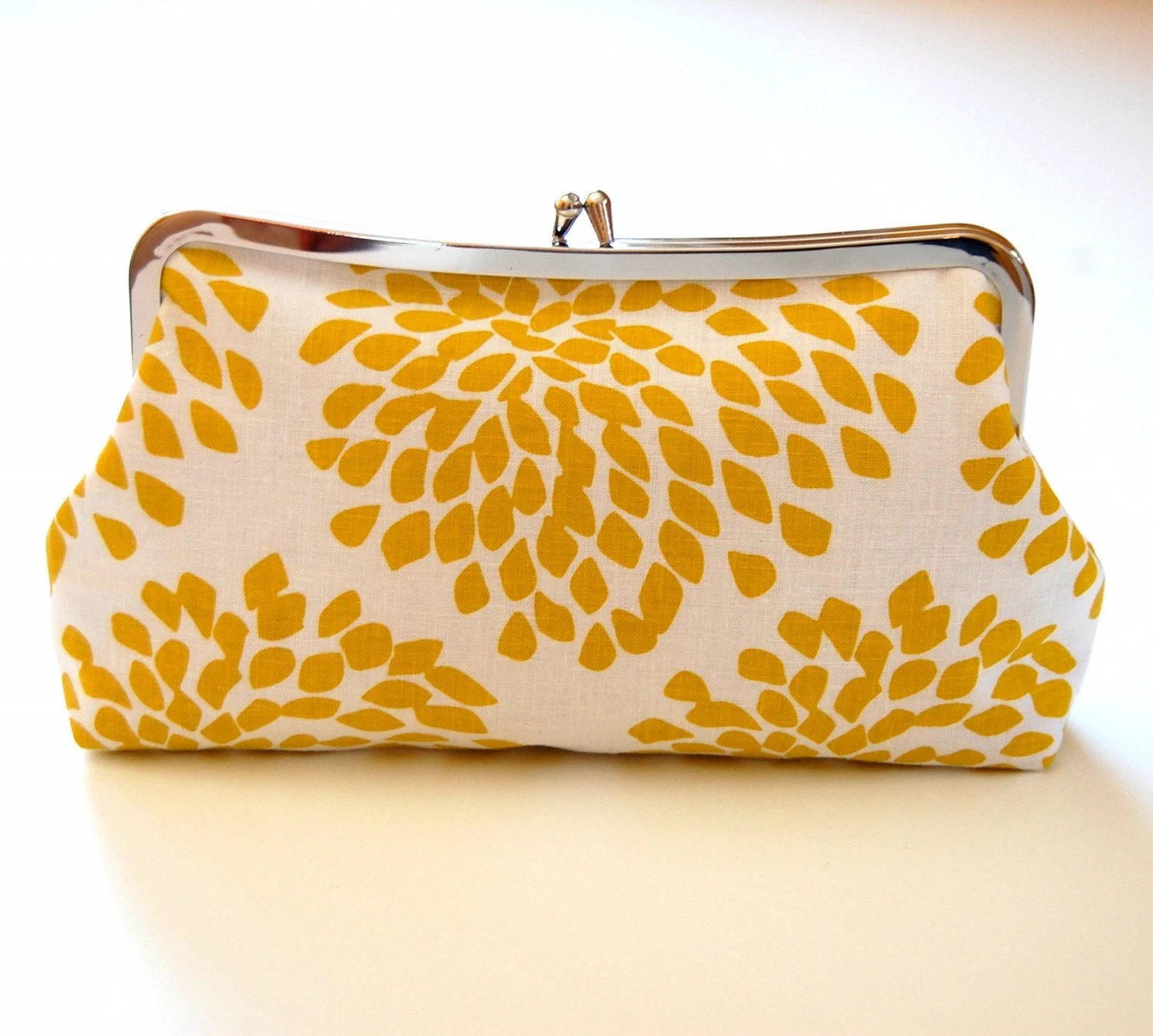 Yellow blossoms clasp clutch purse