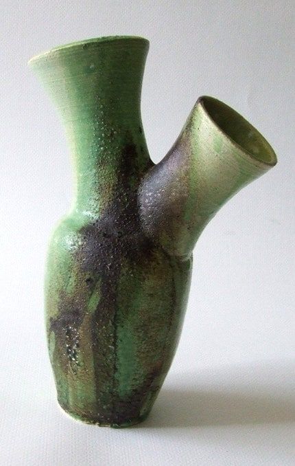In my opinion, the best of the series, this piece has two oversized bottle necks attached and is finished with many different glazes and pure minerals fired directly onto the piece.