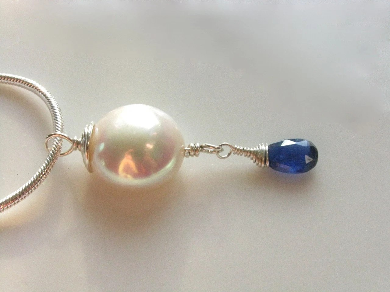Swirl coin pearl and faceted sapphire blue kyanite teardrop pendant necklace