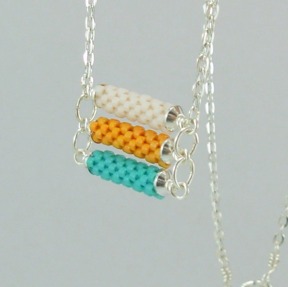 3 tier Beadwoven necklace in turquoise, orange and white
