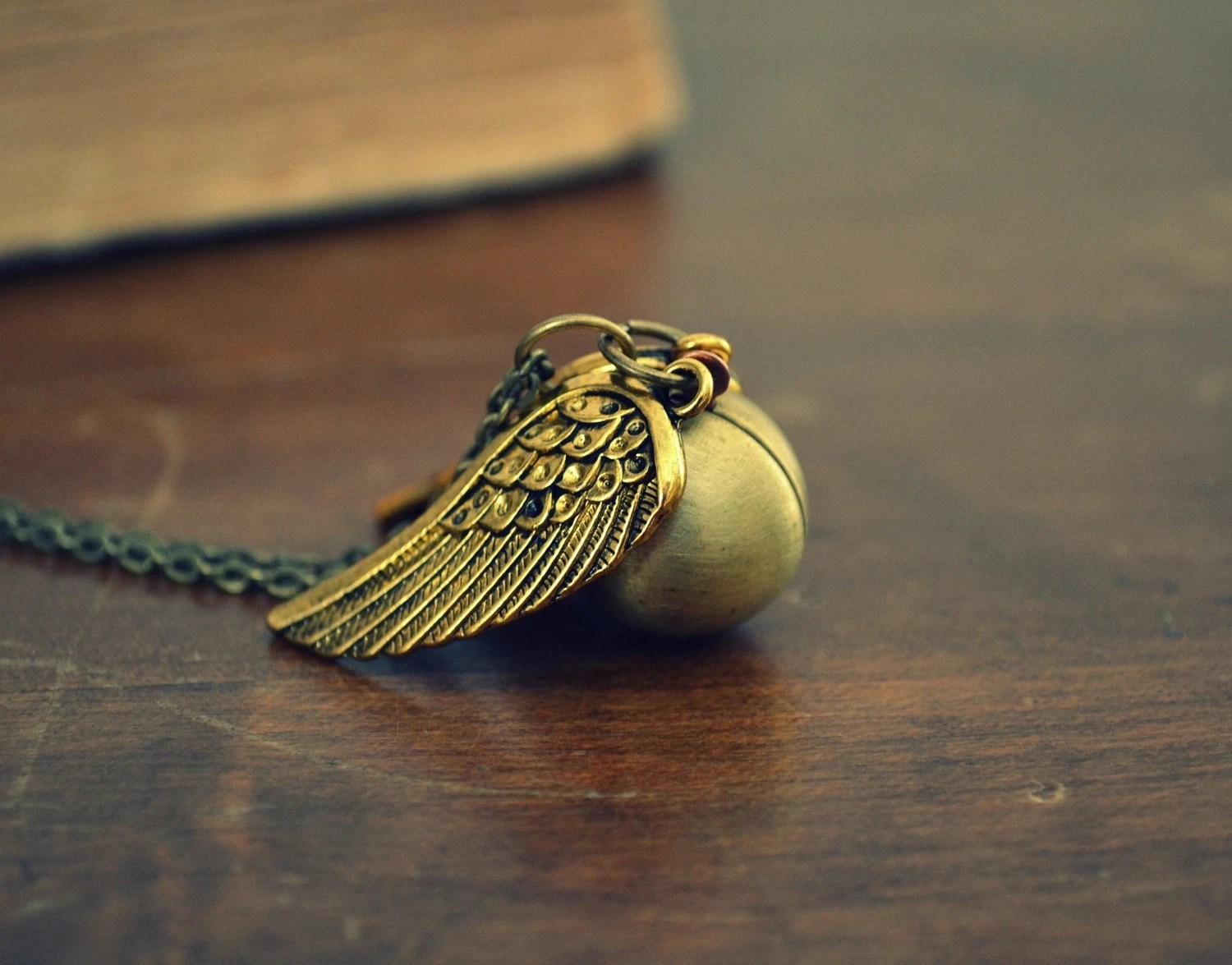 Golden Snitch Ball Locket with Gold Wings Harry Potter