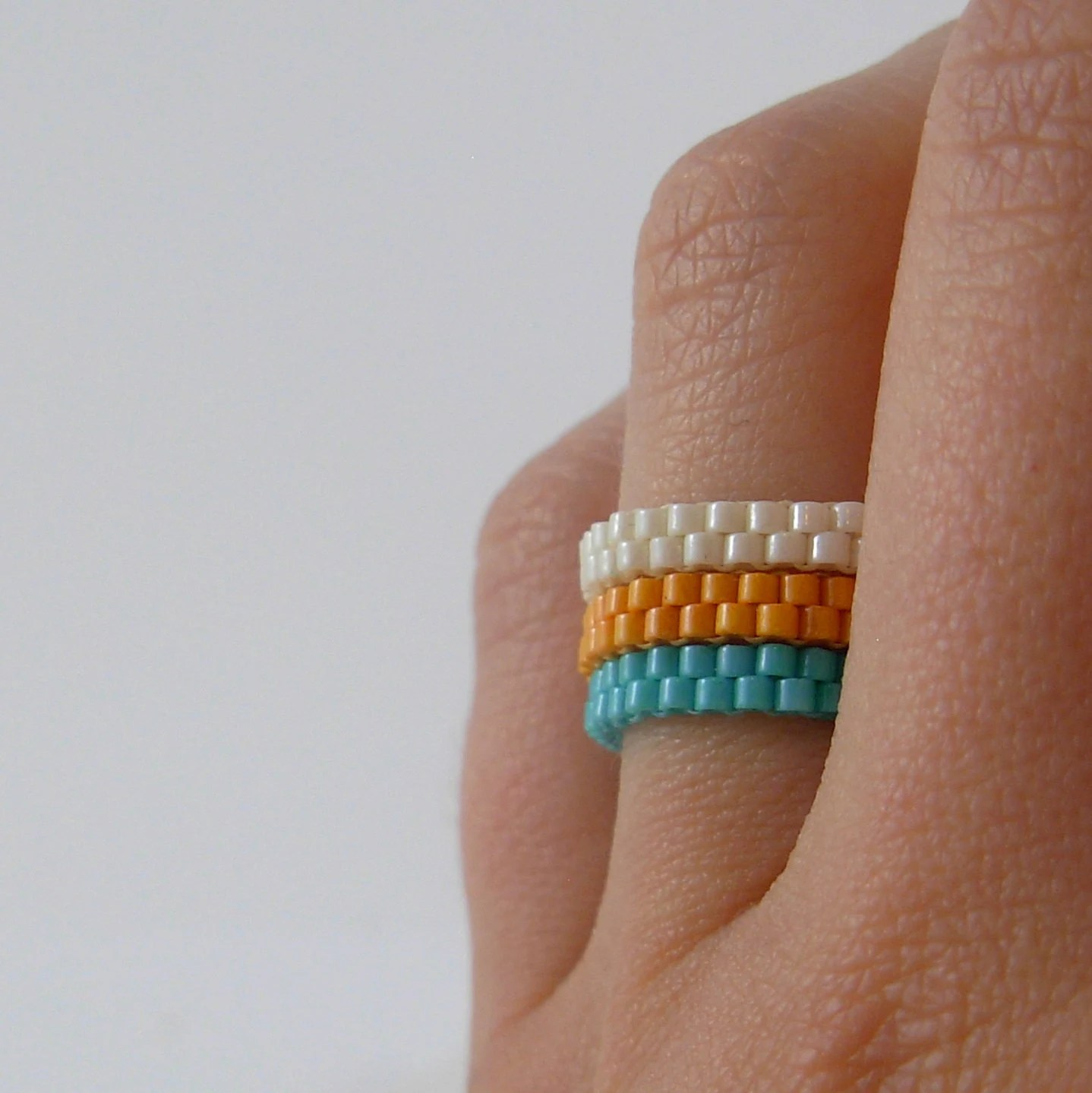 Set of three stackable beadwoven ring in mint orange and cream Size 8