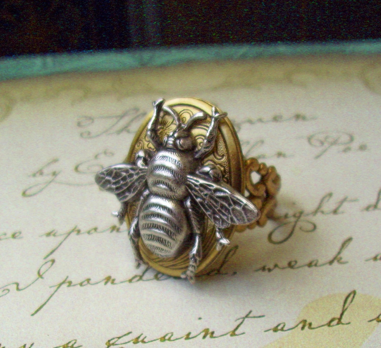 http://www.etsy.com/listing/75864379/steampunk-bumble-bee-locket-ring-working